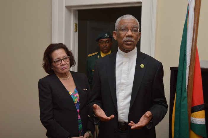 President David Granger addressing the staff of Guyana's Consulate in Barbados as First Lady. Mrs. Sandra Granger listens intently (Photo via Ministry of the Presidency)