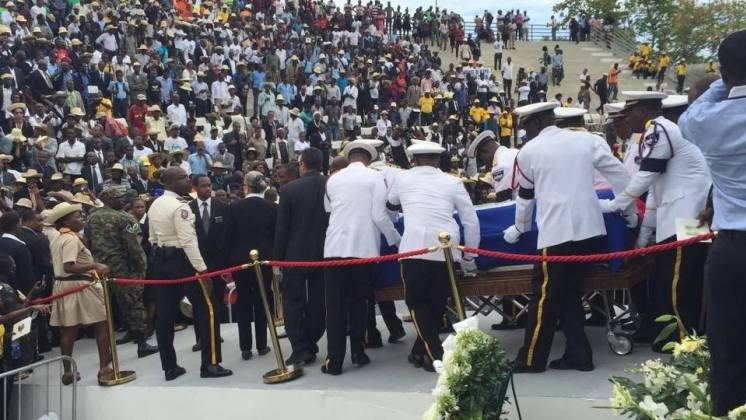 A scene from the funeral ceremony of H.E.René Préval: Pix courtesy of http://www.miamiherald.com/news/nation-world/world/americas/haiti/article137932623.html
