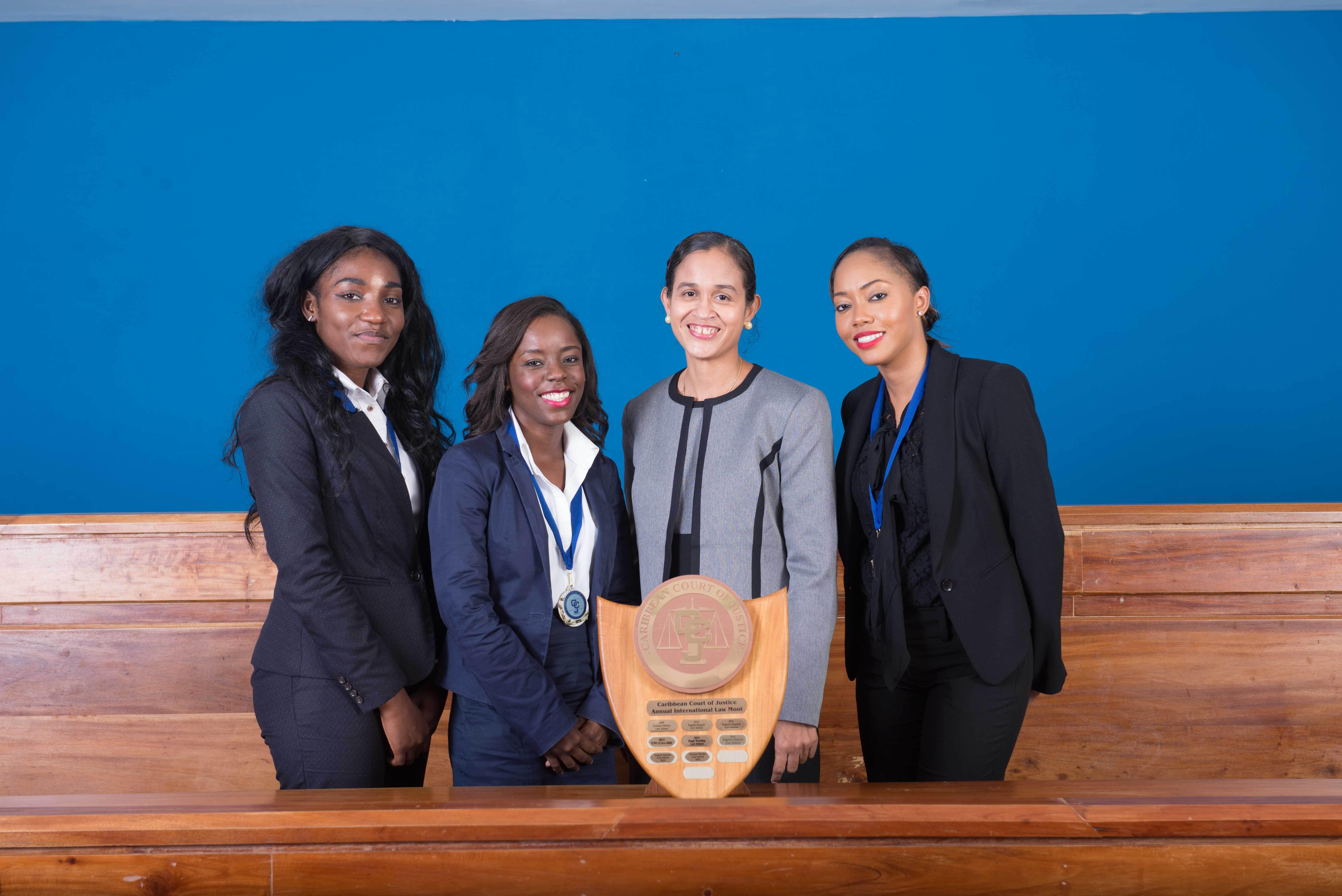 Mrs.JacquelineGraham, (left)presentstheawardfor'BestAcademicInstitution'toTeam UWI,CaveHillCampus(Photos via CCJ) AllfemalewinningteamfromtheEugeneDupuchLawSchool