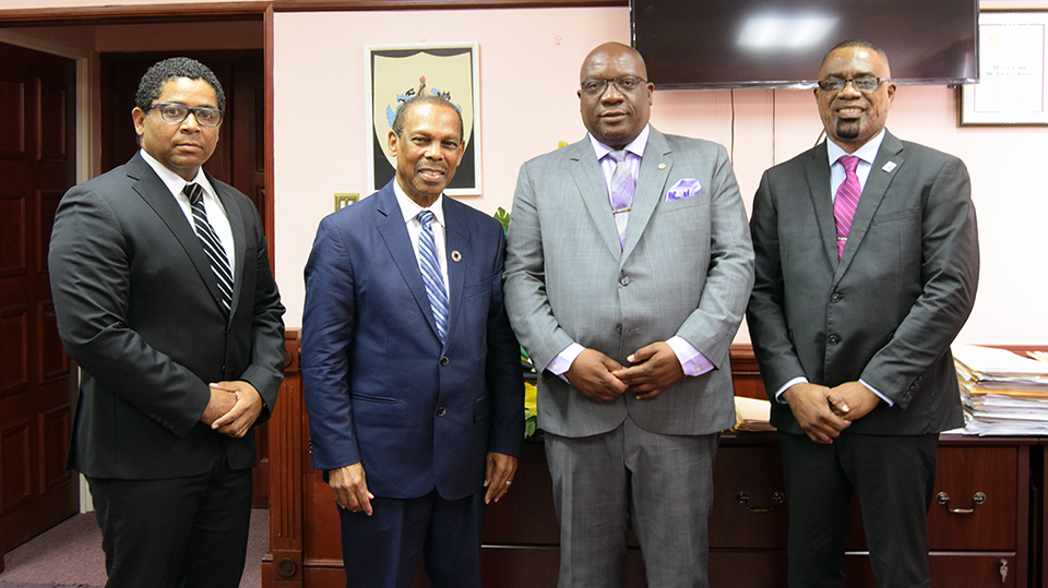 Photo caption (left to right): Special Advisor to the Prime Minister, Mr. Andrew Skerritt; UN Secretary-General Special Envoy for HIV in the Caribbean, Dr. Edward Greene; Prime Minister Dr. the Hon. Timothy Harris; Director of PANCAP's Coordinat