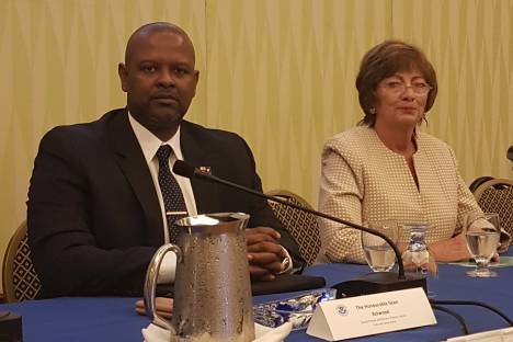 Ministry of Border Control and Employment, Sean Astwood (L), and US Ambassador to Barbados, the Eastern Caribbean and the OECS, Linda Taglialetela