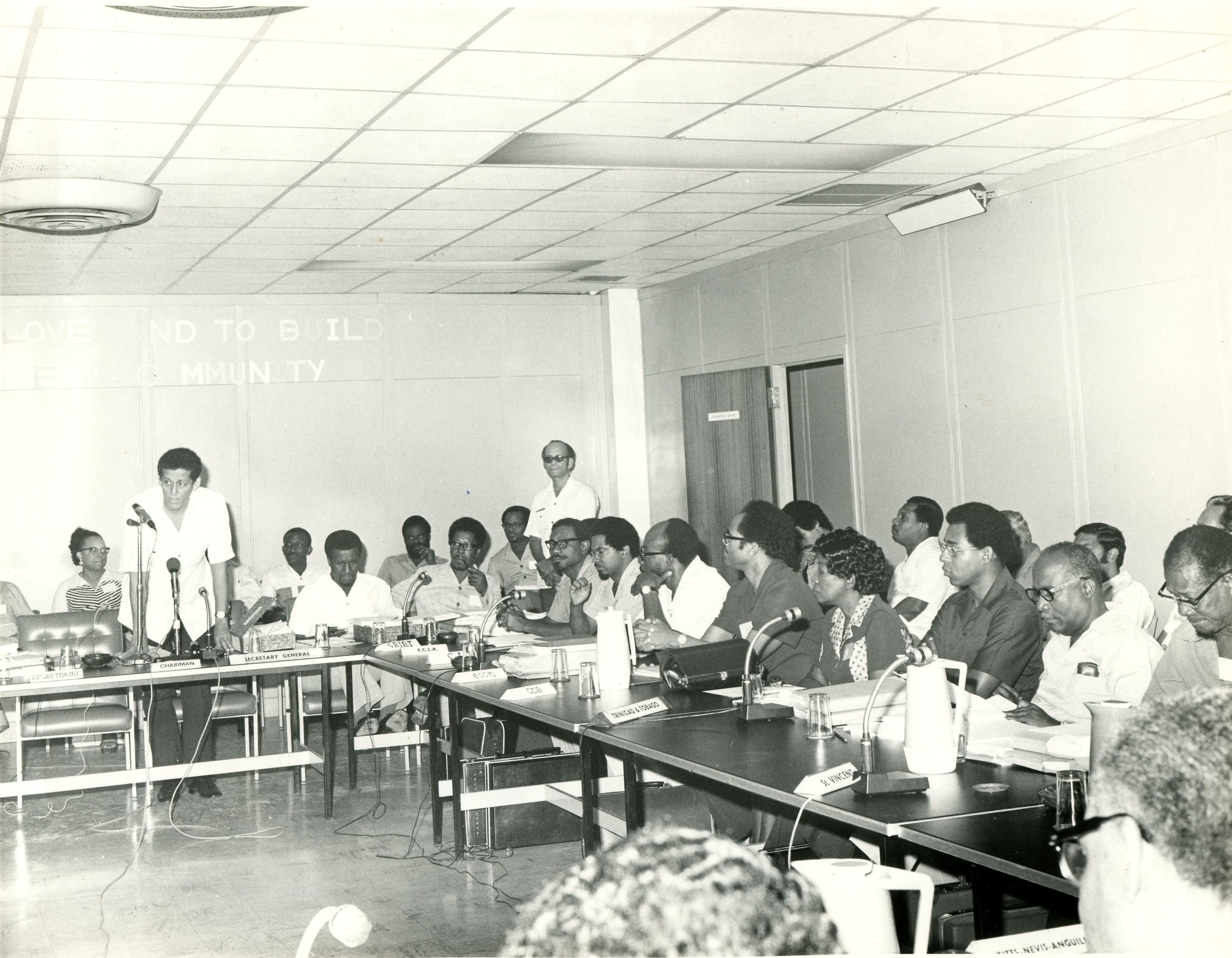Grenadian, Sir Meredith Alister McIntyre, (standing in front of microphones) CARICOM Secretary-General from 1974-1977