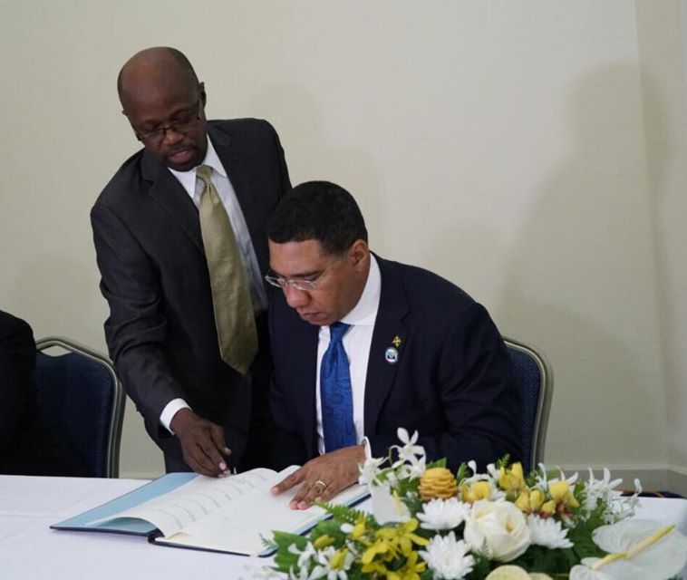 Jamaica's Prime Minister, Andrew Holness, signs the Agreement establishing the Caribbean Centre for Renewable Energy and Energy Efficiency