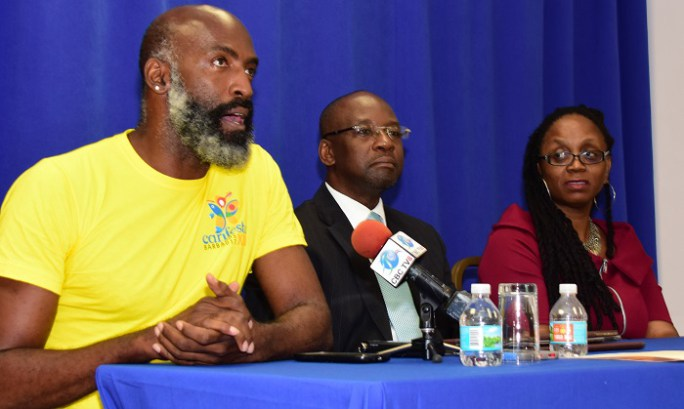 Artistic Coordinator for CARIFESTA XIII, Dr. John Hunte, speaking at the press conference. Looking on are Minister of Cultural, Sports and Youth, the HOn. Stephen Lashley, and Festival Director of the CARIFESTA Secretariat, Ms. Andrea Wells. (Photo v