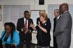 Chile's President, Michelle Bachelet and Executive Director of CDEMA, Ronald Jackson, chatting while on a tour of the Agency's headquarters today. Also pictured is Attorney General and Minister of Home Affairs, Adriel Brathwaite (right).