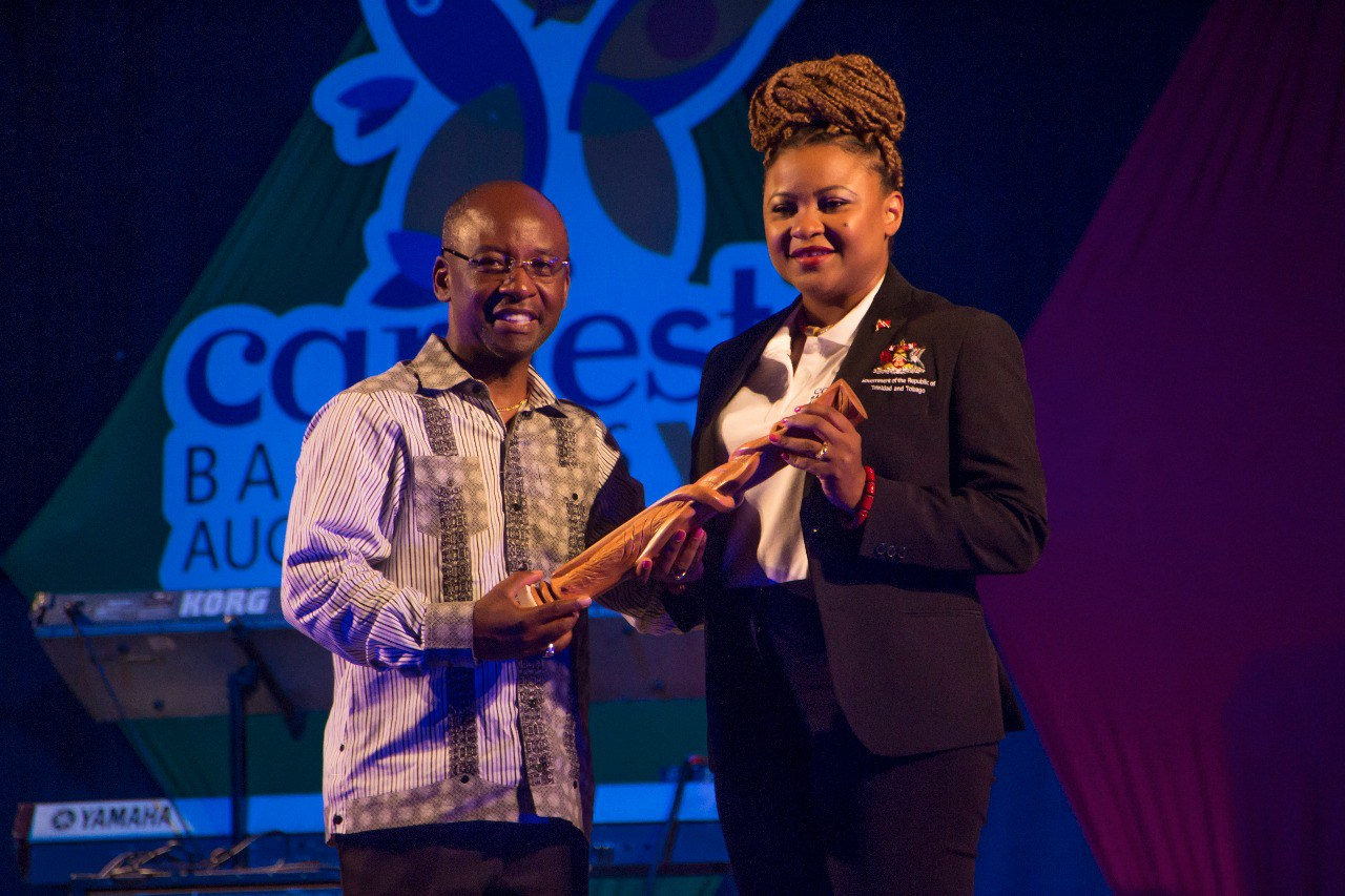Barbados Minister of Culture, Sports and Youth Stephen Lashley handing over baton to CARIFESTA XIIII 2019 host country Trinidad and Tobago, Minister of Culture and Art, Dr Nyan Gadsby.