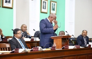 Prime Minister Dr.Hubert Minnis wipes away tears in the House of Assembly. (Photo via Terrel W Carey/Tribune staff)
