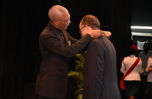 President of Guyana, His Excellency David Granger bestows the Cacique's Crown of Honour on CARICOM Secretary-General, Ambassador Irwin LaRocque at the National Cultural Centre, Georgetown, Guyana, 6 October, 2017.