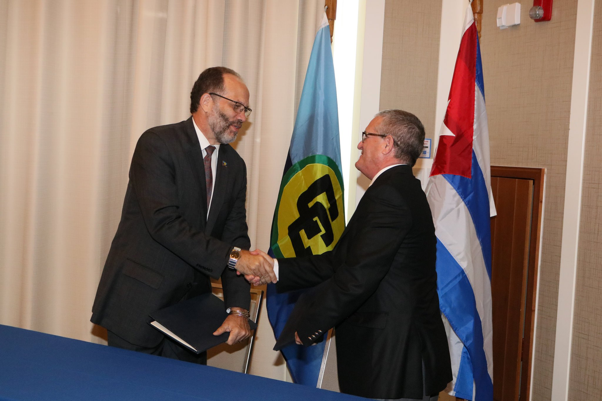 Caricom-cuba-signing-ceremony-hnadshake-between-sg-and-amb.-marchante