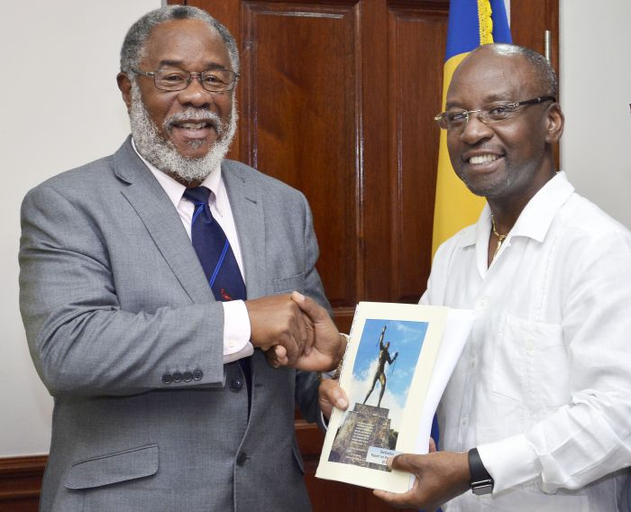 Chairperson of the Reparations Task Force, Professor Emeritus, Pedro Welch presents Minister of Culture, Sports and Youth Stephen Lashley, with a copy of the report on reparations. (W.Alleyne Associates/BGIS)