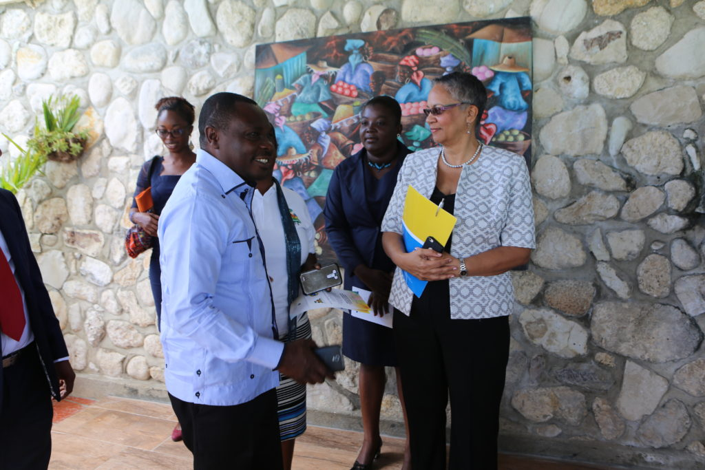 H.E. Pierre Simon Georges, Minister of Environment, Haiti (left) and Monica La Bennett, Vice-President (Operations), CDB (right), discuss how the project will positively impact the lives of Ile-à-Vache's residents. (Photo via CDB)