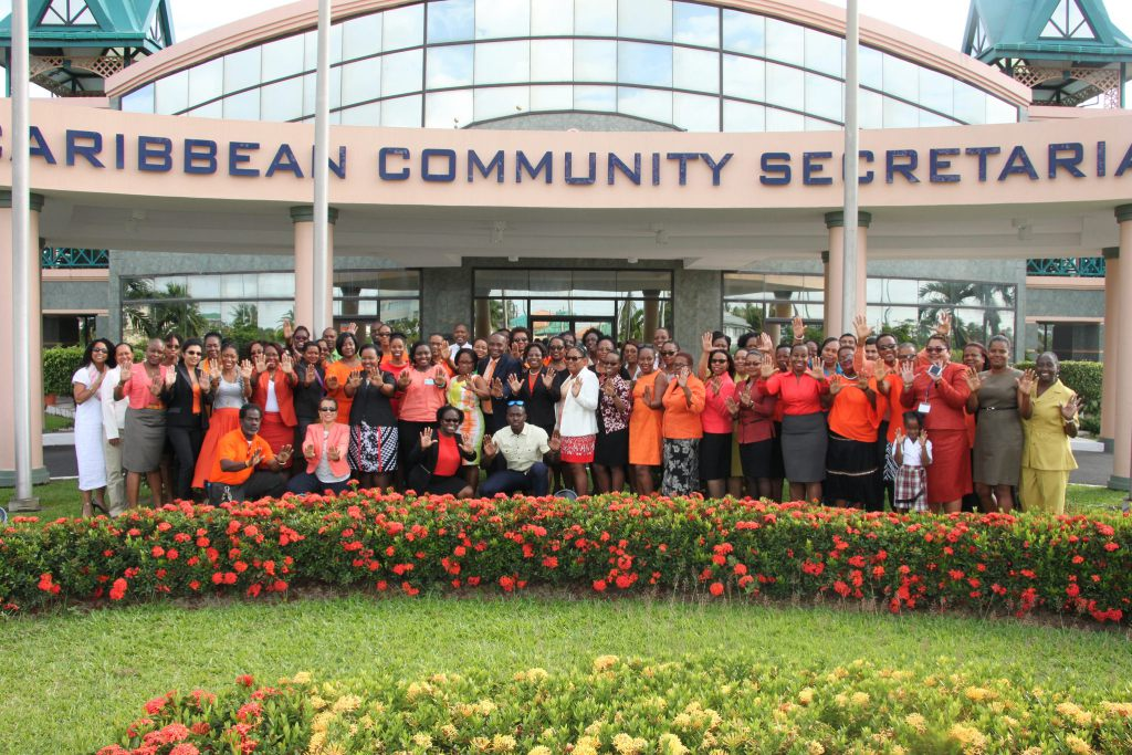 #PressforProgress: CARICOM Secretariat members of staff - most dressed in orange - pose for a group photograph on International Women's Day 2018