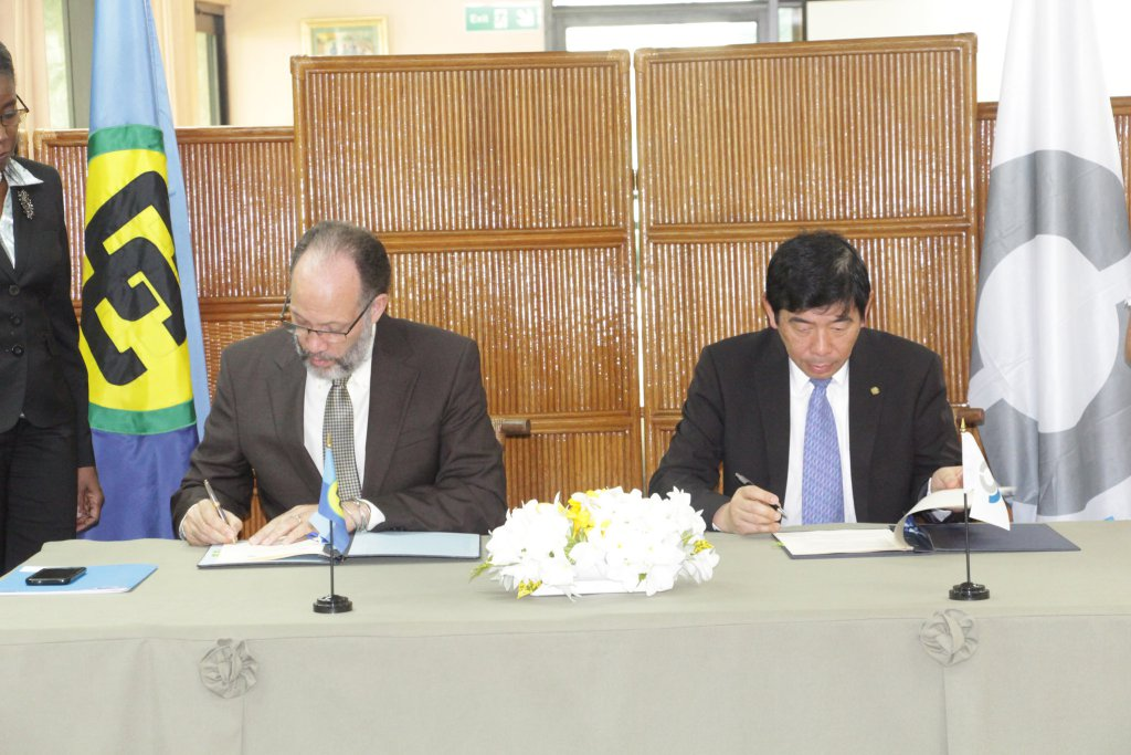 CARICOM Secretary-General, Ambassador Irwin LaRocque and World Customs Organisations Secretary-General, Kunio Mikuriya sign the Memorandum of Understanding
