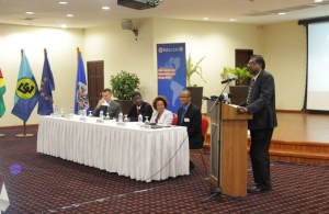Minister Khemraj Ramjattan at the podium. Also in photograph are, from left, Mr. Terry Steers-Gonzalez, Chargé d' Affaires, US Embassy in Guyana; Mr Jean-Ricot Dormeus, OAS/CICAD Representative to Guyana; Ms. Beverly Reynolds, Coordinator