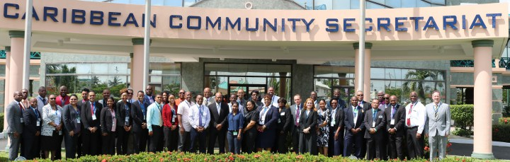 Delegates and facilitators pause for a photo op after the opening ceremony of the Workshop at the CARICOM Secretariat Tuesday morning