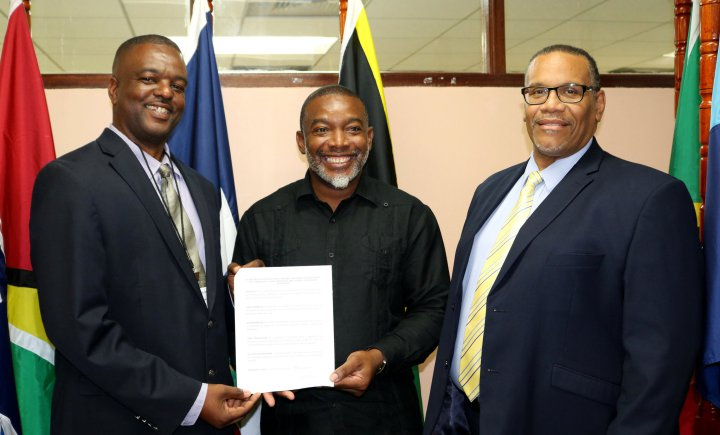 From left, the Hon. Paul Lewis, Minister of Communications, Works and Labour, Montserrat; Dr. Devon Gardner, Programme Manager, Energy, CARICOM Secretariat; and Mr. Joseph Cox, Assistant Secretary-General, Trade and Economic Integration, CARICOM Secr