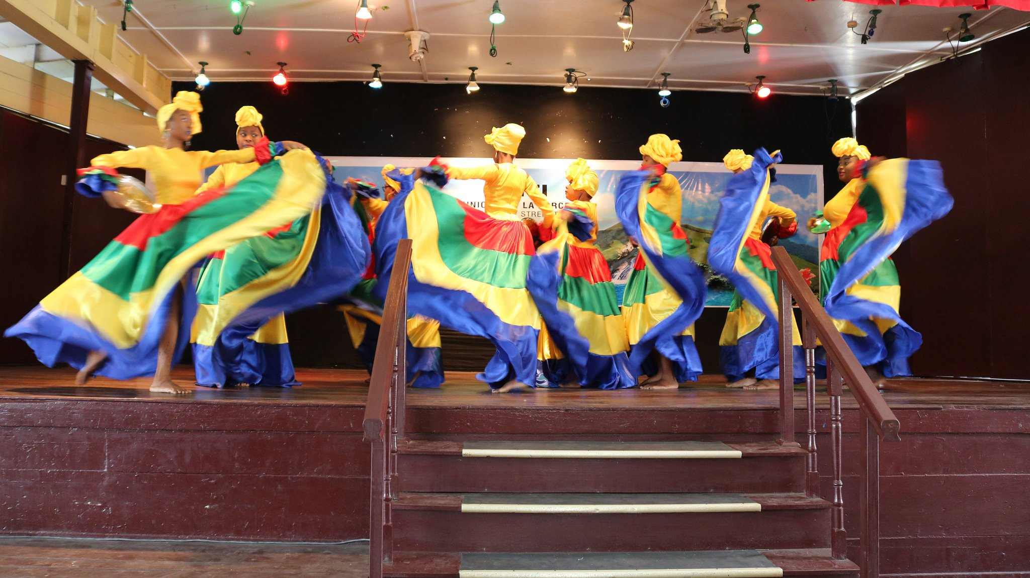 A riot of colour as Form 3C performs a Haitian dance