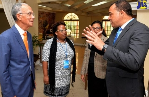 Minister of Health, Dr. the Hon. Christopher Tufton (right), speaks with (from left): President, Healthy Caribbean Coalition, Sir Trevor Hassell; Director, Non-Communicable Diseases and Injury Prevention, Ministry of Health, Dr. Tamu Davidson; and Ac