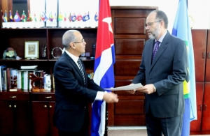 CARICOM Secretary-General, Ambassador Irwin LaRocque (right) accepts the Letter of Credence of His Excellency Narciso Reinaldo Amador Socorro, new Plenipotentiary Representative of Cuba to CARICOM