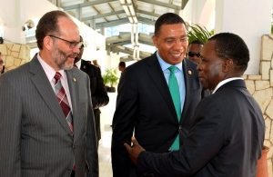 CARICOM Secretary-General, Amb. Irwin LaRocque (l), CARICOM Chairman, the Most Hon. Andrew Holness, Prime Minister of Jamaica (c) and Dr. the Rt. Hon Keith Mitchell, Prime Minister of Grenada in discussion on Wednesday (Photo via Jamaica Information
