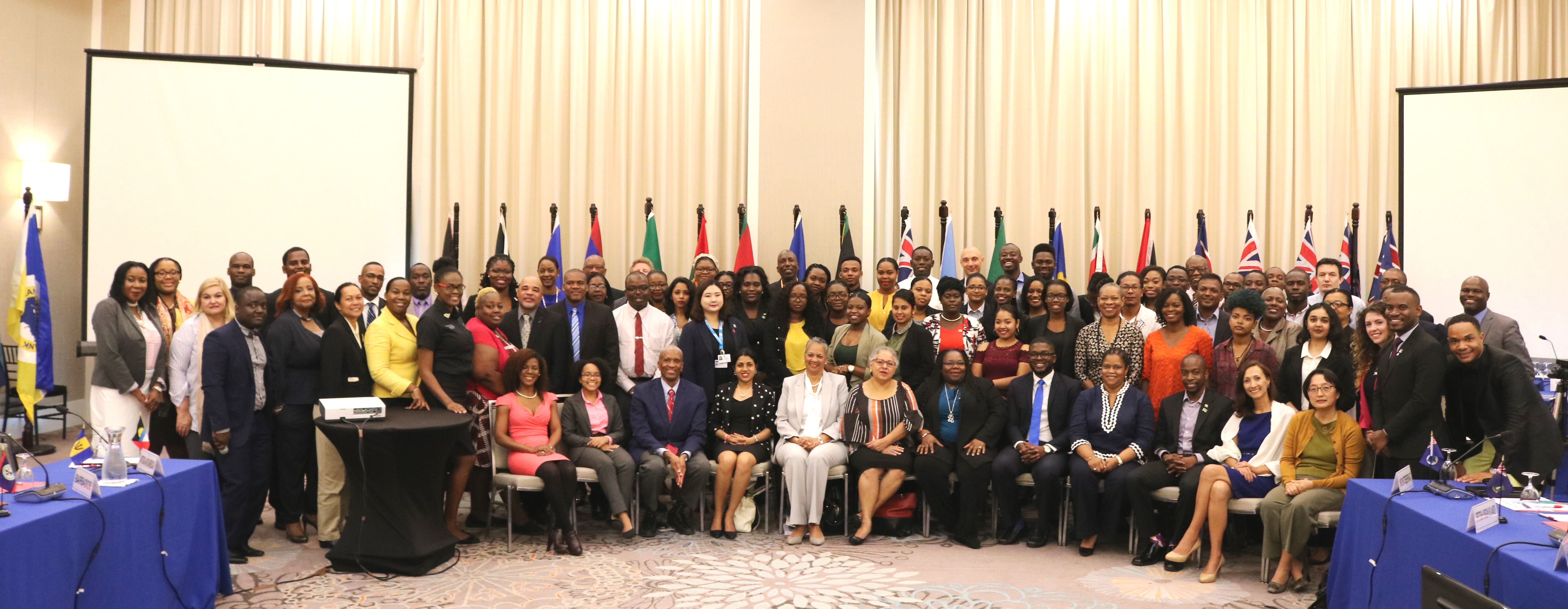 A group photo following the opening of the Caribbean Forum on Youth Population and Development