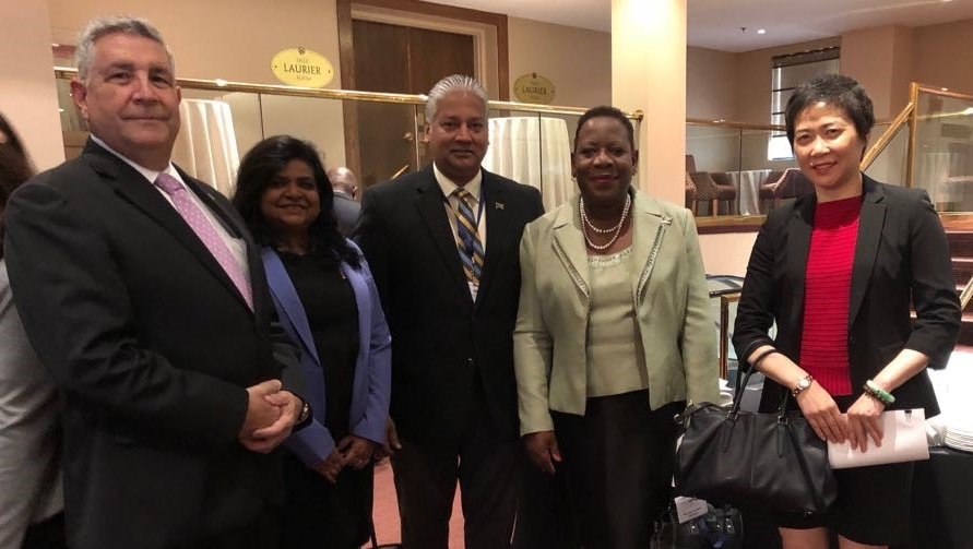 Dr Pauline Yearwood (2nd right)  meeting with the Secretary-General of ICAO, Dr Fang Liu (right)