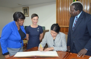 CARICOM Deputy Secretary-General signs guest book at Jamaica House of Assembly