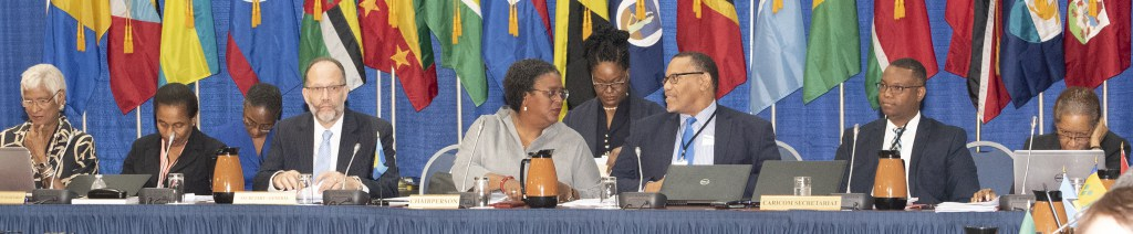 Chair of the Meeting, Prime Minister Mia Mottley of Barbados (4th left), Secretary-General Ambassador Irwin LaRocque (3rd left) and CARICOM Secretariat officials at the Head Table