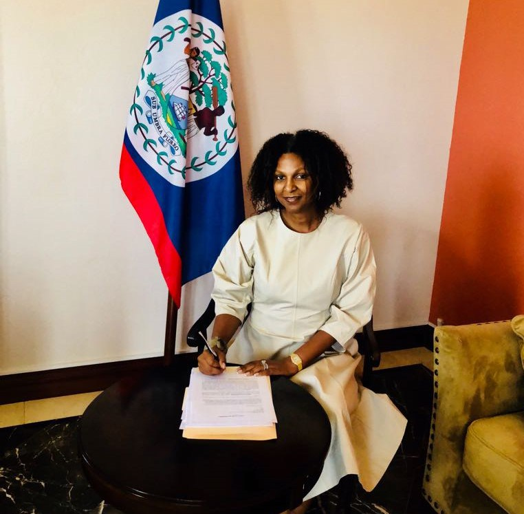 Hon. Kim Simplis-Barrow, Belize's Special Envoy for Women and Children and Chair of the Spouses of CARICOM Leaders Action Network (SCLAN) signs the document