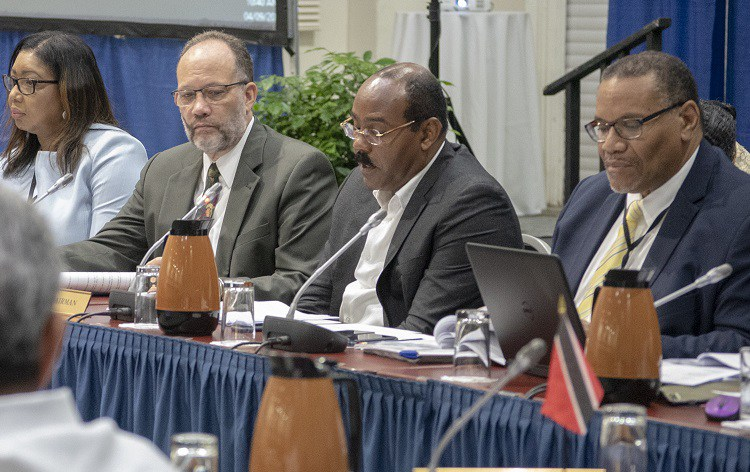 Chairman of the Meeting, Prime Minister and Minister of Finance of Antigua and Barbuda, Gaston Browne (2nd right) addresses the meeting, with CARICOM Secretary-General Ambassador Irwin LaRocque (3rd right); Assistant Secretary-General Joseph Cox (rig