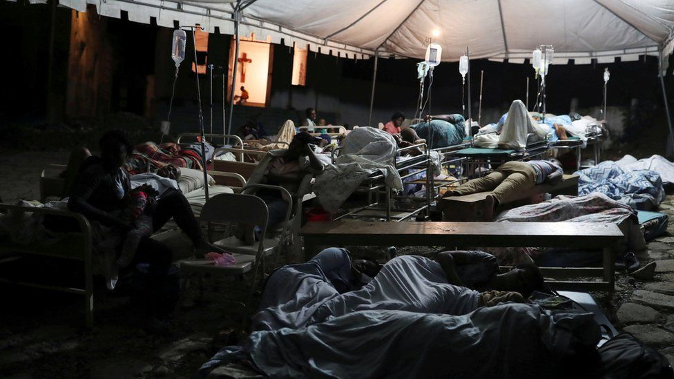 The injured sleep in a tent near Port-de-Paix, Haiti (Photo by Reuters via BBC)