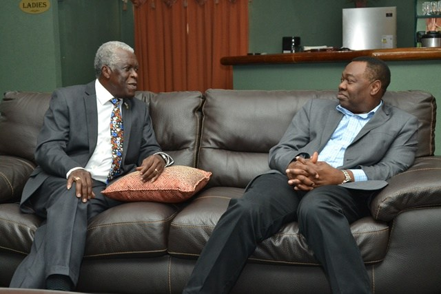 olonel, Egbert Field [left] and President of the International Civil Aviation Organisation (ICAO), Dr. Olumuyiwa Benard Aliu in discussion at the Roraima Longe at CJIA. (Photo via DPI)