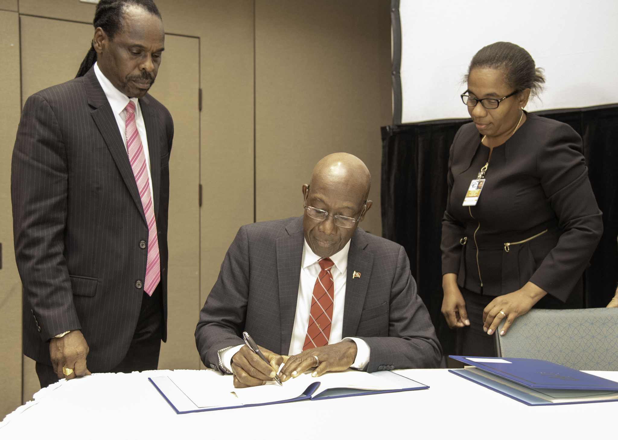 Prime Minister Rowley signs agreements