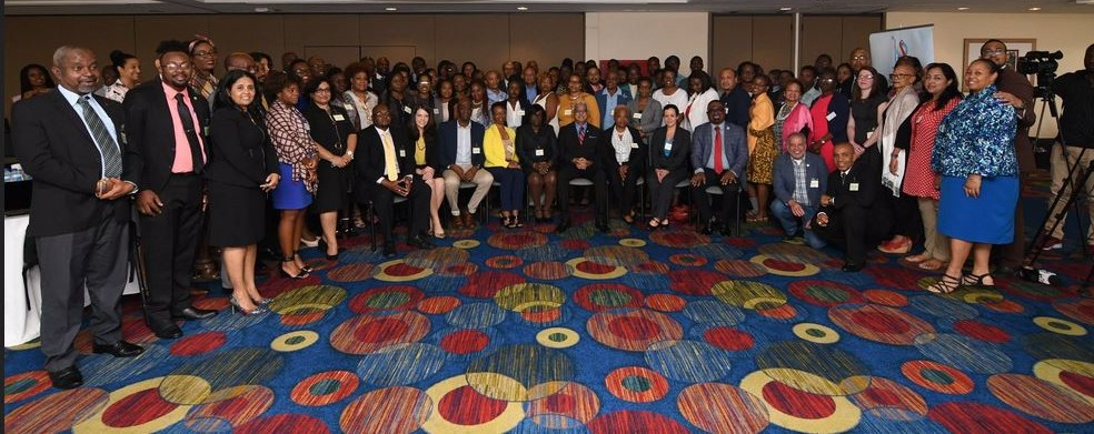 Hon. Terrence Deyalsingh, Minister of Health, Republic of Trinidad and Tobago with participants of the Seventh Meeting of National AIDS Programme Managers and Key Partners