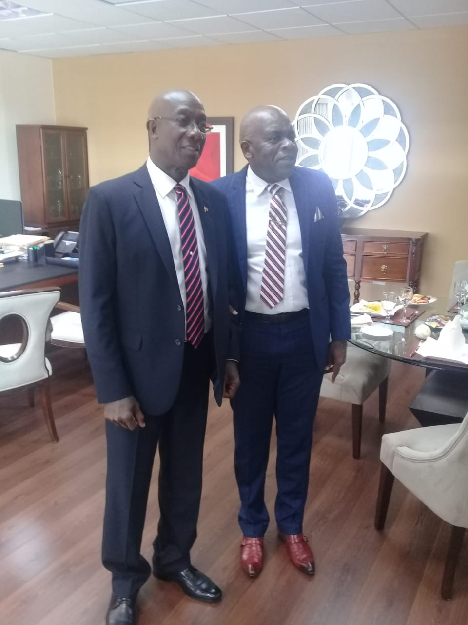 The CARICOM Special Rapporteur on Disability, Senator Dr. Floyd Morris (R) pays a courtesy call on Trinidad and Tobago Prime Minister, Hon. Dr. Ketih Rowley (L) in his office