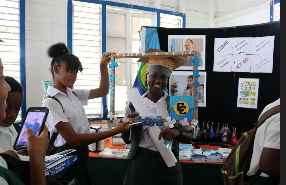 FLASHBACK: School girls at the CARICOM Booth at a 2018 career fair in Georgetown, Guyana