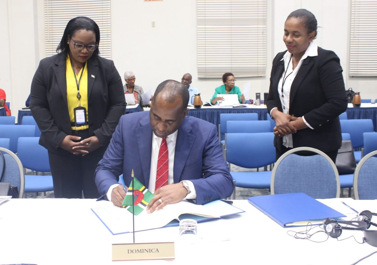 Dominica's Prime Minister Mr Roosevelt Skerrit signs Regional Procurement and Assets Recovery Agreements
