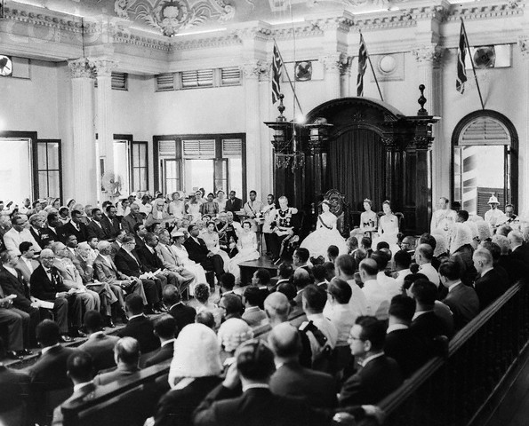 22 Apr 1958, Port-of-Spain, Trinidad, Trinidad and Tobago --- 4/22/1958-Port of Spain, Trinidad-General view of the chamber during the Inauguration of the Federal Legislature of the West Indies.  The ceremony, officiated by Princess Margaret, brought into formal being the newest member of the British Commonwealth, the West Indies Federation.  Seated to the left of the Princess in this photo is Lord Hailes, Governor General of the Federation. --- Image by © Bettmann/CORBIS