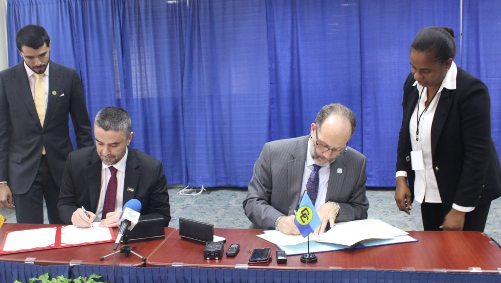 CARICOM Secretary-General Ambassador Irwin LaRocque (right) and UAE Assistant Minister Omar Saif Ghobash sign the MOU