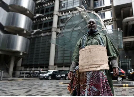 A demonstrator in front of Lloyds of London which recently apologised for its role in the Atlantic slave trade (Photo via Reuters)