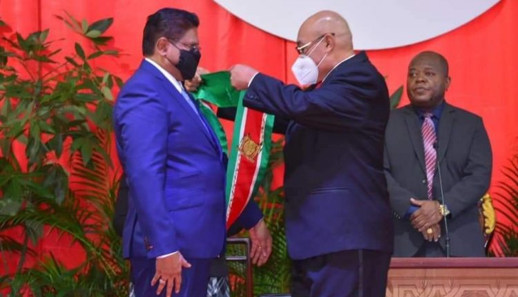 Santokhi was congratulated and presented with the presidential sash by his predecessor Desi Bouterse
